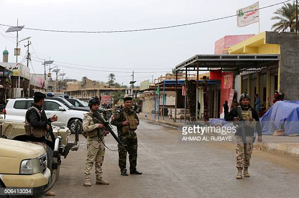Iraqi policemen guard the area as Sunni and Shiite tribal clerics and leaders meet to dicuss reconciliation between the Muslim sects and recent...
