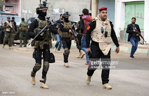 Iraqi policemen guard the area as Sunni and Shiite tribal clerics and leaders meet to discuss reconciliation between the Muslim sects and how to...