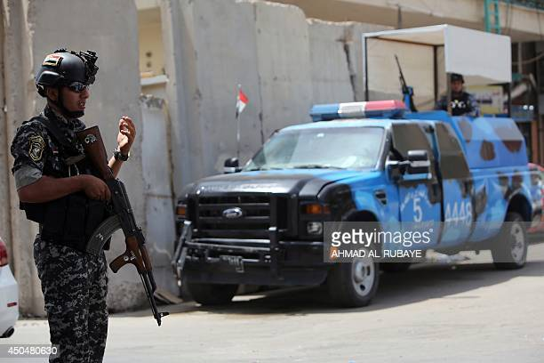 Iraqi policemen man a checkpoint in the capital Baghdad on June 12 as jihadists and anti-government fighters have spearheaded a major offensive that...