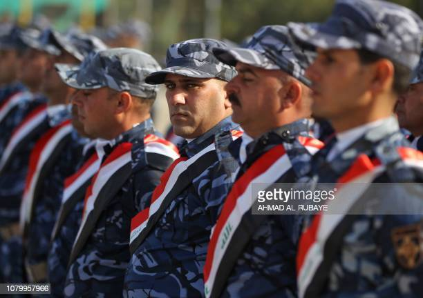 Iraqi policemen march during a parade in Baghdad on January 10 2019 to mark the graduation of 158 Iraqi policemen after a sixmonth training period