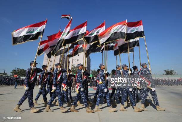 TOPSHOT Iraqi policemen march during a parade in Baghdad on January 10 2019 to mark the graduation of 158 Iraqi policemen after a sixmonth training...