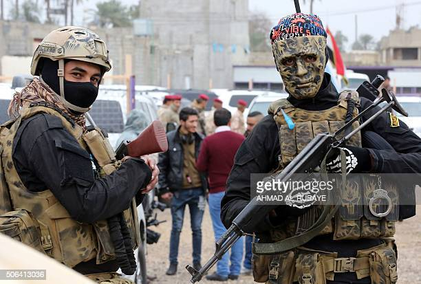 Iraqi policemen stand guard as Sunni and Shiite tribal clerics and leaders meet to discuss reconciliation between the Muslim sects and how to prevent...