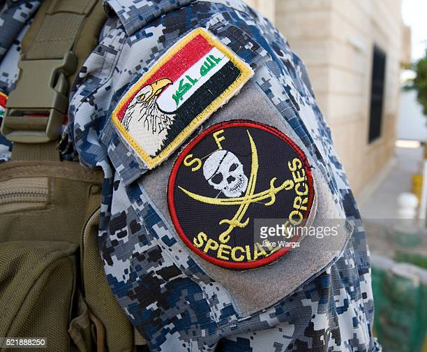 iraqi policenam with arm patches - jake warga stock pictures, royalty-free photos & images