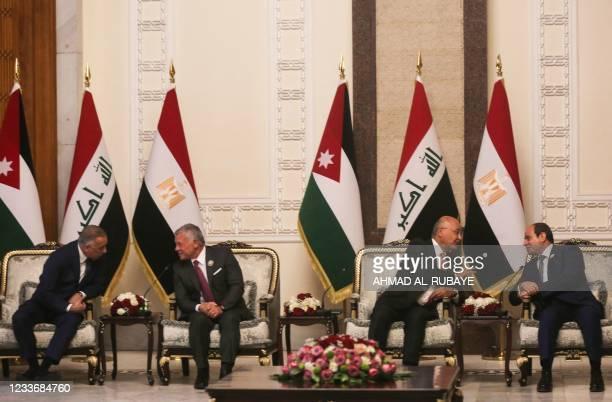 Iraqi President Barham Saleh and Prime Minister Mustafa Al-Kazemi receive Egypt's President Abdel Fattah al-Sisi , and Jordan's King Abdullah II , in...