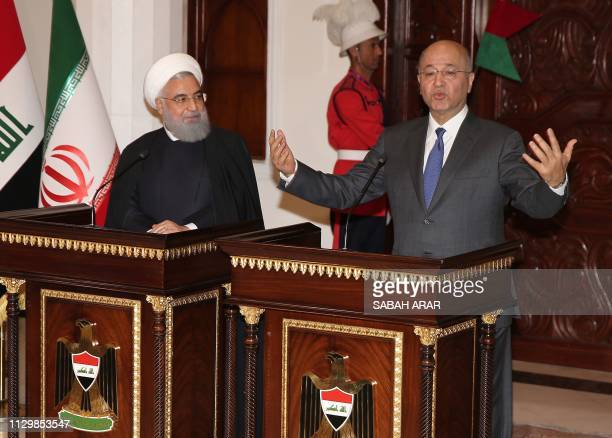 Iraqi President Barham Saleh gestures during a joint press conference with his Iranian counterpart Hassan Rouhani at the Presidential palace in...