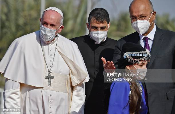 Iraqi President Barham Saleh welcomes Pope Francis at the presidential palace in Baghdad's Green Zone on March 5, 2021 at the start of the first...