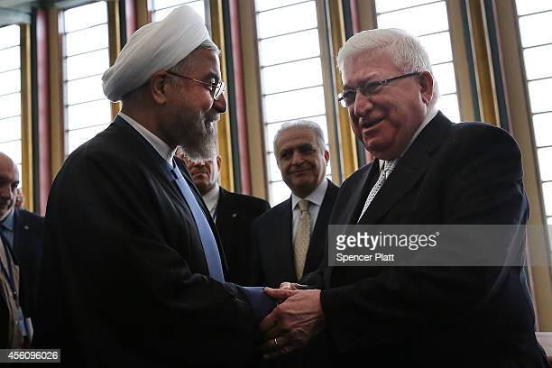 Iraqi President Fuad Masum shakes hands with Iranian President Hassan Rouhani following a meeting at the United Nations on September 25 2014 in New...