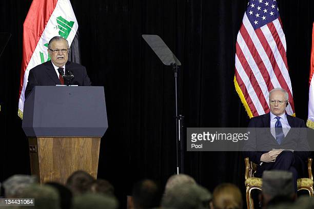Iraqi President Jalal Talabani speaks as US Ambassador to Iraq James Jeffrey listens during a special ceremony at Camp Victory one of the last...