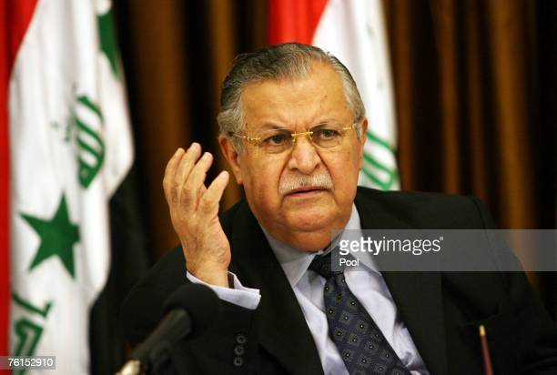 Iraqi President Jalal Talabani speaks at the signing ceremony of a three page agreement on a new alliance of moderate Shiites and Kurds at a meeting...