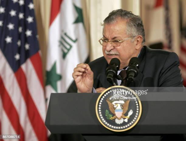 Iraqi President Jalal Talabani speaks to the media during a brief press conference with US President George W Bush in the East Room of the White...