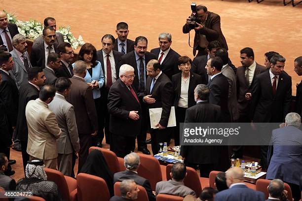 Iraqi President Muhammad Fuad Masum comes to parliament after the announcement of the new government in Baghdad Iraq on September 8 2014 A diverse...