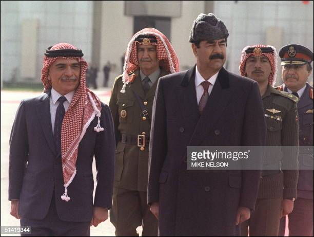 Iraqi President Saddam Hussein and King Hussein of Jordan reviewing the honor guard upon Saddam's arrival to Amman 24 February 1990 for the first...