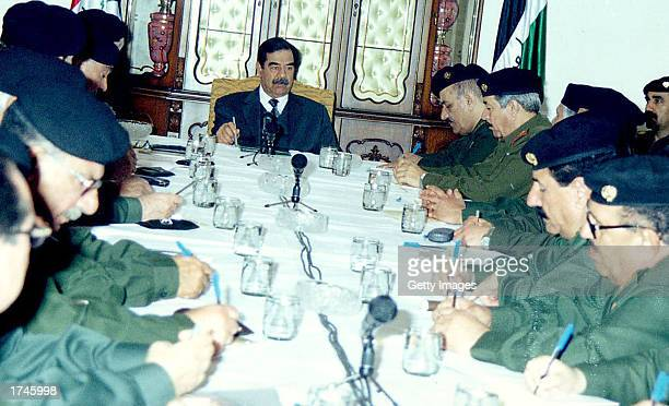 Iraqi President Saddam Hussein meets with his Revolutionary Command Council January 26 2003 in Baghdad Iraq The US warned Iraq January 26 it would...