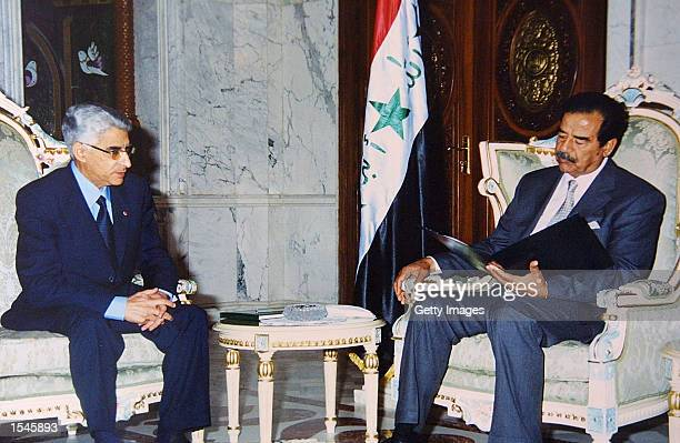 Iraqi President Saddam Hussein reads a message from King Mohammed VI of Morocco pertaining to Arab issues and bilateral relations May 30 2002 in...