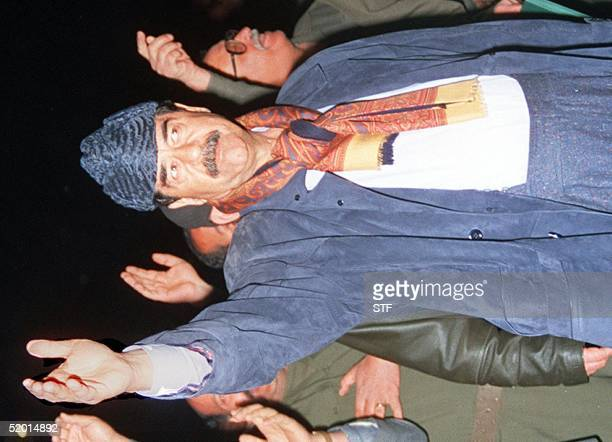 Iraqi President Saddam Hussein salutes the crowd of supporters which gathered to greet him during his visit late 07 March to the northern areas of...