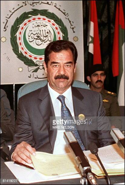 Iraqi President Saddam Hussein shown in file picture dated 28 May 1990 in Baghdad addresses the opening session of the Extraordinary Arab Summit...