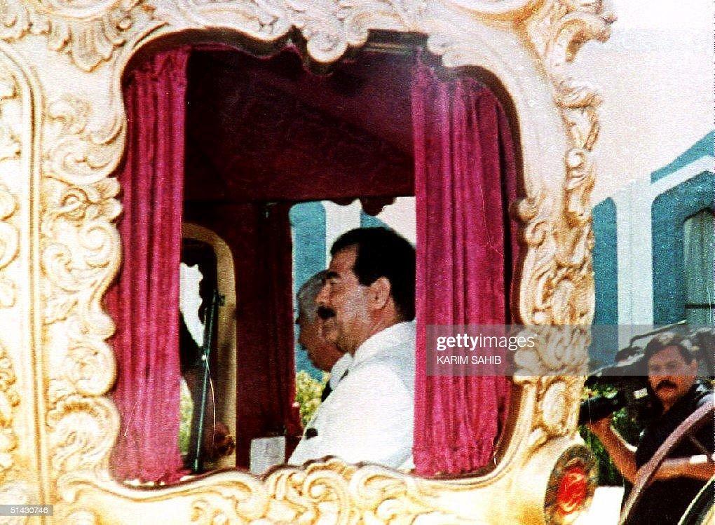 Iraqi President Saddam Hussein sits in a carriage : News Photo