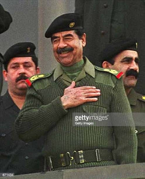 Iraqi President Saddam Hussein smiles January 1 2001 while attending a military show in Baghdad Iraq