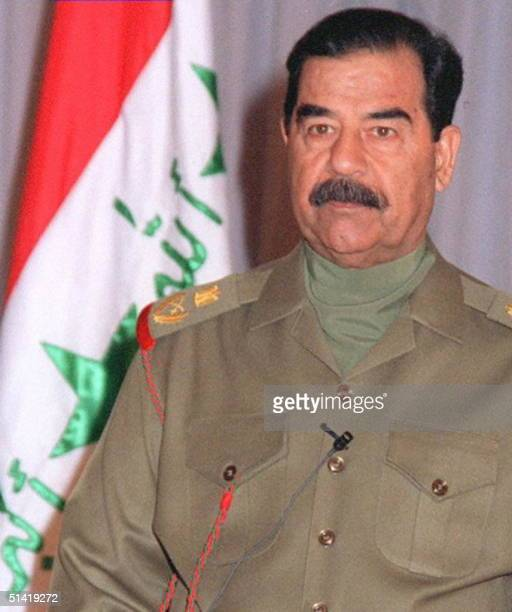 Iraqi President Saddam Hussein speaks to the press 17 December 1997 in Baghdad to mark the seventh anniversary of the start of the Gulf War over...