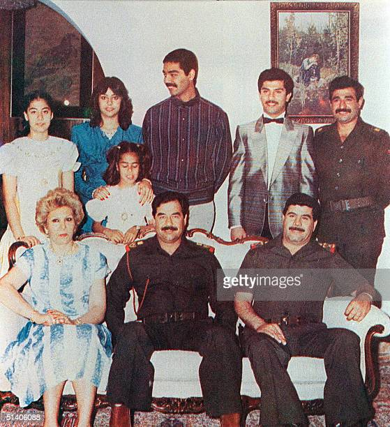 Iraqi President Saddam Hussein surrounded by his family in Bagdad his first wife Sajiba and his daughters Hala Rana and Raghad Hussein's sonsinlaw...