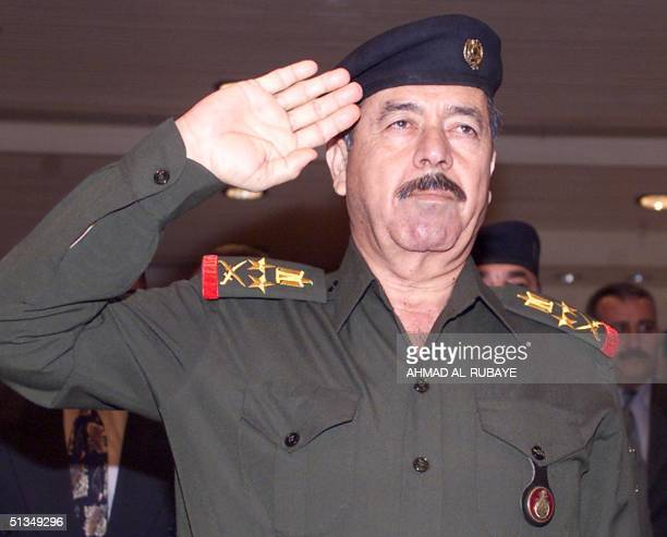 Iraqi President Saddam Hussein's cousin Ali Hassain alMajeed a member of the Iraqi Revolutionary Command Council attend a meeting in Baghdad 20...