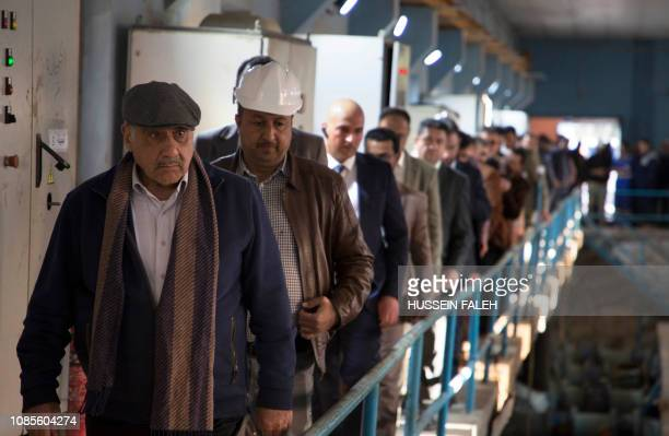 Iraqi Prime Minister Adel Abdul Mahdi visits a water project installation during a trip to the southern city of Basra on January 20 2019 Mahdi...