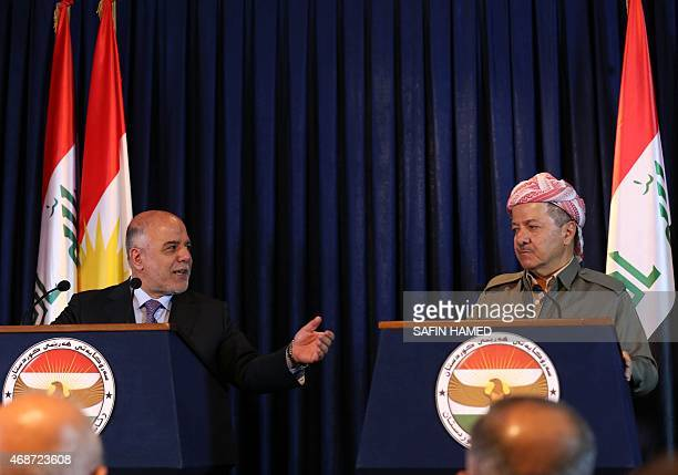 Iraqi Prime Minister Hadier alAbadi gestures during a press conference with Iraqi Kurdish leader Massud Barzani in Arbil the capital of the...