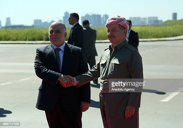 Iraqi Prime Minister Haidar al-Abadi is welcomed by Kurdistan Regional Government President Masoud Barzani upon his arrival at Erbil International...