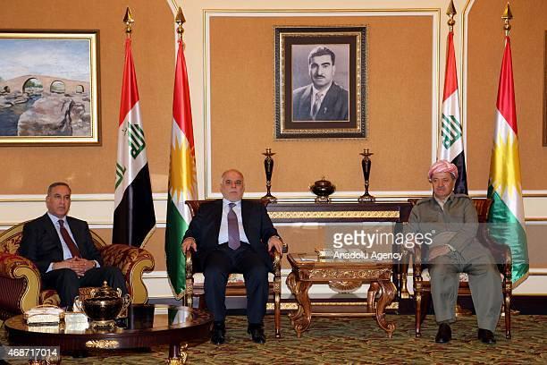 Iraqi Prime Minister Haidar al-Abadi meets with Kurdistan Regional Government President Masoud Barzani upon his arrival at Erbil International...