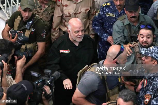Iraqi Prime Minister Haider alAbadi is seen after retaken Mosul on July 9 2017 in Mosul Iraq