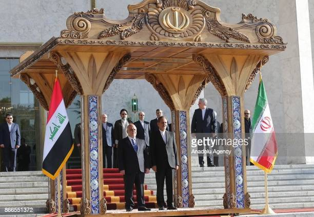 Iraqi Prime Minister Haider alAbadi is welcomed by Iran's First Vice President Eshaq Jahangiri with an official ceremony in Tehran Iran on October 26...