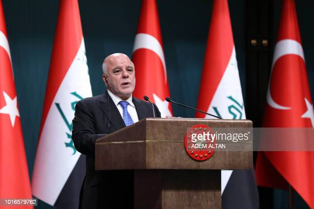 Iraqi Prime Minister Haider alAbadi speaks during a joint press conference with the Turkish president following their meeting at the Presidential...