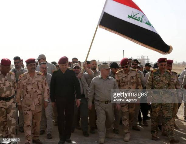 Iraqi Prime Minister Haider alAbadi visits Qaim town and Husaybah border gate newlyliberated town from Daesh terrorists in Anbar Iraq on November 5...