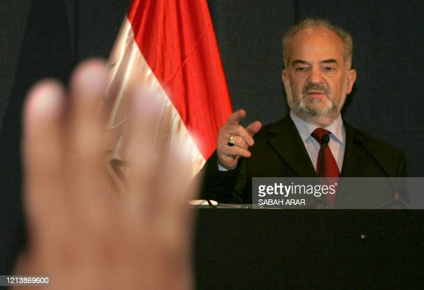 Iraqi Prime Minister Ibrahim Jaafari gestures to a journalist waiting to ask a question 23 August 2005 in Baghdad's fortified Green Zone Jaafari said...