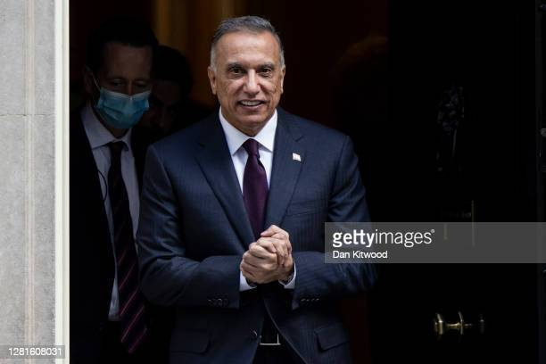 Iraqi Prime Minister Mustafa AlKadhimi leaves Downing Street after a meeting with British Prime Minister Boris Johnson on October 22 2020 in London...