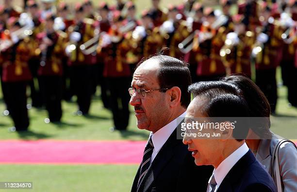 Iraqi Prime Minister Nouri alMaliki and South Korean President Lee MyungBak walk during a welcoming ceremony held at the presidential Blue House on...
