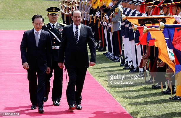 Iraqi Prime Minister Nouri alMaliki and South Korean President Lee MyungBak walk towards a guard of honour during a welcoming ceremony held at the...
