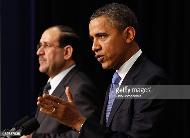 Iraqi Prime Minister Nouri AlMaliki and US President Barack Obama hold a news conference in the Eisenhower Executive Office Building next to the...