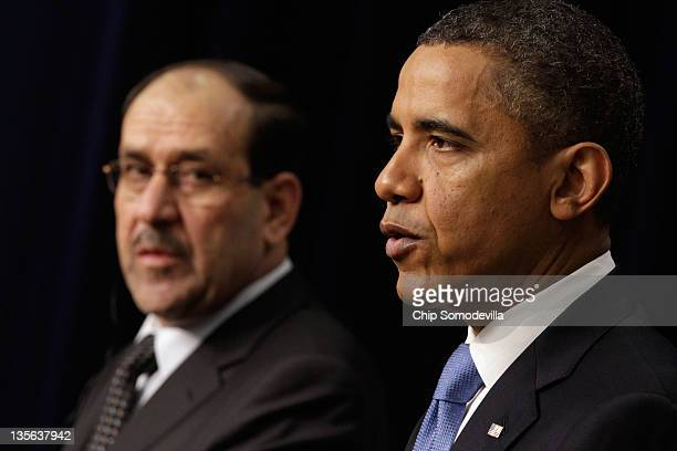 Iraqi Prime Minister Nouri Al-Maliki and U.S. President Barack Obama hold a news conference in the Eisenhower Executive Office Building next to the...