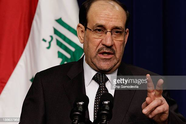 Iraqi Prime Minister Nouri AlMaliki answers reporters' questions during a news conference with US President Barack Obama in the Eisenhower Executive...