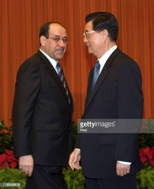 Iraqi Prime Minister Nouri alMaliki left meets with Chinese President Hu Jintao ahead of a bilateral meeting at the Great Hall of the People on July...