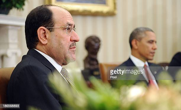 Iraqi Prime Minister Nouri AlMaliki meets with US President Barack Obama in the Oval Office at the White House November 1 2013 in Washington DC...