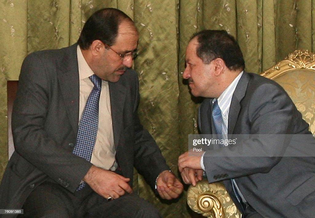 Iraq's PM Nuri al-Maliki sits next to former PM Ibrahim Jaafari during a meeting in Baghdad : News Photo
