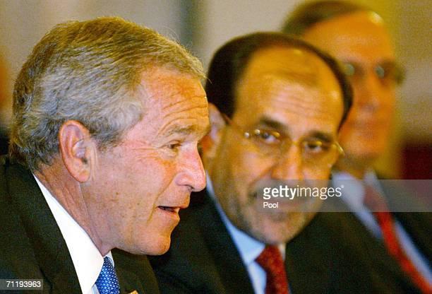 Iraqi Prime Minister Nuri alMaliki looks at US President George W Bush during their on June 13 2006 in Baghdad Iraq Bush told Maliki that Iraq's...