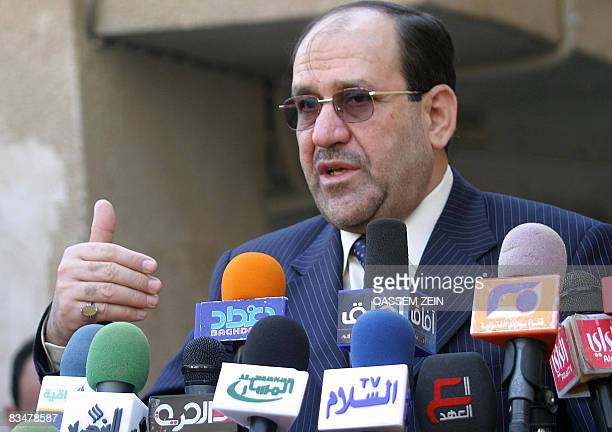 Iraqi Prime Minister Nuri alMaliki talks to the press after a meeting with Iraq's top Shiite cleric Grand Ayatollah Ali alSistani in Najaf on October...