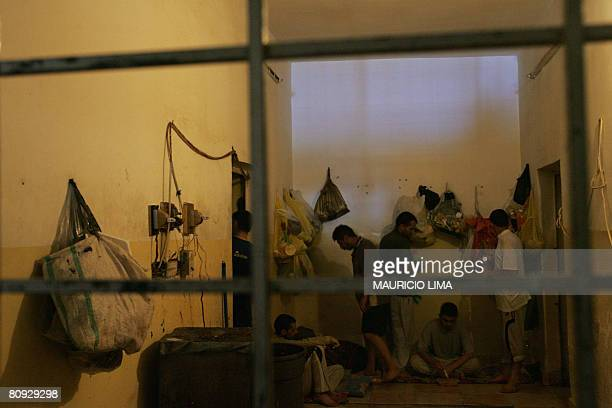 Iraqi prisoners are seen inside a cell as they wait to receive lunch at an Iraqi police station in Mahmudiyah some 30 kilometres south of Baghdad on...