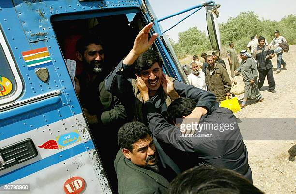 Iraqi prisoners from the AbuGhraib prison celebrate after being released May 4 2004 in Tikrit Iraq Approximately 200 Iraqi prisoners were escorted to...
