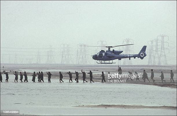 Iraqi prisoners in Kuwait escorted by a Saudi helicopter on February 27th 1991