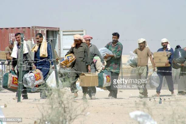 Iraqi prisoners of war leave Camp Bucca near the southern Iraqi port of Umm Qasr after their release 06 May 2003 Some 150 Iraqi POWs were set free...