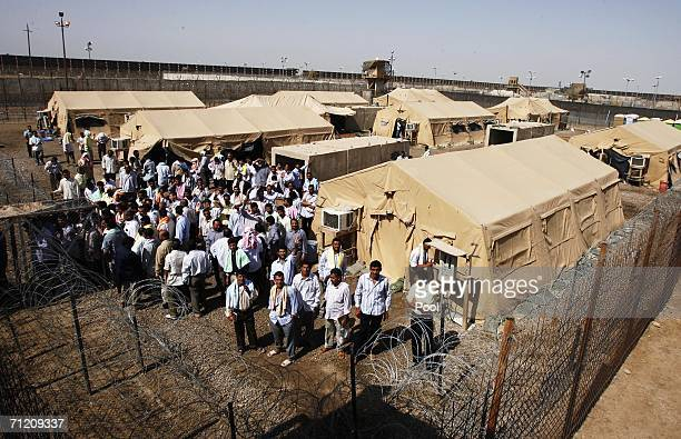 Iraqi prisoners wait inside the prison compound shortly before another batch of 200 prisoners are freed from Abu Ghraib prison on June 15 2006 in...